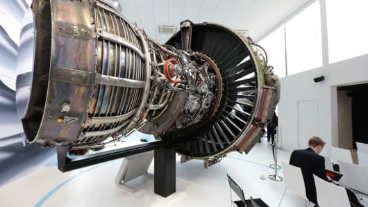 A General Electric (GE) GEnx next generation jet engine sits on display in the GE Aviation Systems LLC chalet on the opening day of the 51st International Paris Air Show in Paris, France.