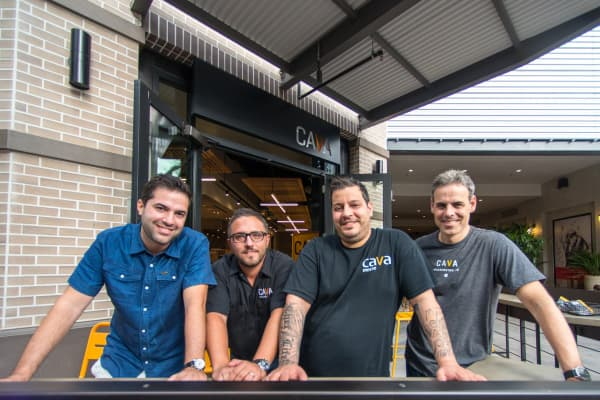 Former equity trader Brett Schulman (far right) joined forces with the co-founders of Cava Mezze to make their Mediterranean product a recognizable food brand.