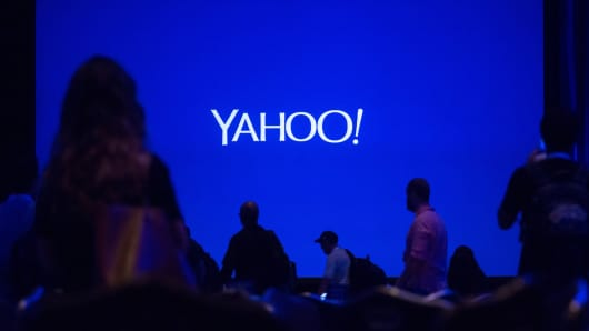 Silhouettes of attendees are seen before the start of the Yahoo! Inc. conference