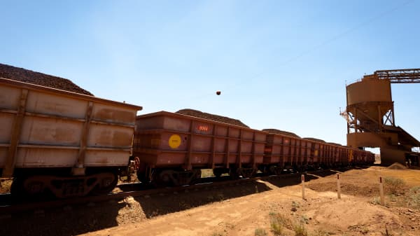 A train loader fills train carriages with lump iron ore at Rio Tinto Group's West Angelas iron ore mine in Pilbara. The miner's plans to replace trains with driverless ones hit a delay in Q1.