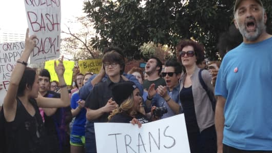 People protest outside the North Carolina Executive Mansion in Raleigh on March 24, 2016, against a South Carolina proposal to forbid transgender people from using restrooms that correspond to their gender identity.