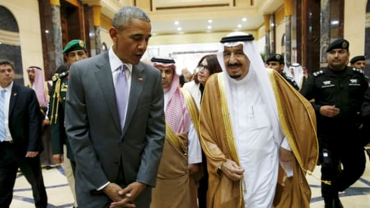President Barack Obama walks with Saudi King Salman at Erga Palace upon arriving for a summit meeting in Riyadh, Saudi Arabia April 20, 2016.