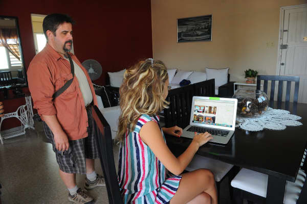A Cuban woman provides a reservation service from a laptop in Havana, on July 10, 2015.