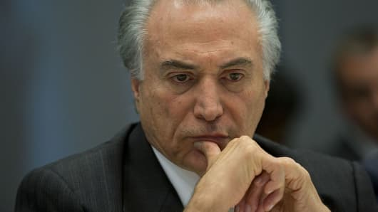 Michel Temer listens during an interview in New York, U.S.