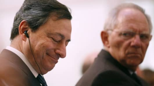 Mario Draghi, president of the European Central Bank (ECB), left, and Wolfgang Schaeuble, Germany's finance minister.