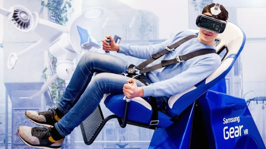 A man sits in a 'Whiplash' chair at the Gear VR pop-up store of Samsung in Amsterdam, on February 25, 2016.