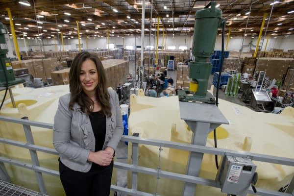 Earth Friendly Products CEO Kelly Vlahakis-Hanks at the grand opening of the flagship sustainability manufacturing facility in Cypress, CA.