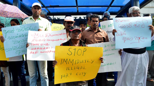 Activists demonstrate in Colombo in March 2015 over the $1.4B Chinese-funded Port City project, which began construction in 2014 despite claims of the sea reclamation process would cause environmental damage.