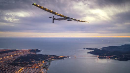 Solar powered plane 'Solar Impulse 2', piloted by Swiss adventurer Bertrand Piccard, flys over the Golden Gate bridge in San Francisco, after a flight from Hawaii