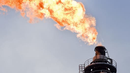 Oil refinery with fire,