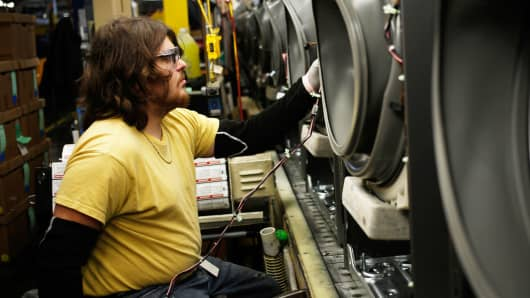 A worker assembles washing machines at the Whirlpool manufacturing facility in Clyde, Ohio.