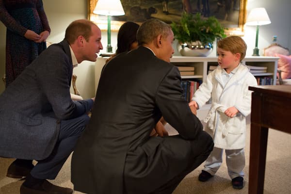 President Barack Obama, Prince William, Duke of Cambridge and First Lady Michelle Obama talks with Prince George at Kensington Palace on April 22, 2016 in London, England