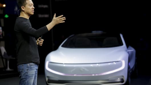 "Jia Yueting, co-founder and head of Le Holdings Co Ltd, also known as LeEco and formerly as LeTV, gestures as he unveils an all-electric battery ""concept"" car called LeSEE during a ceremony in Beijing, China April 20, 2016."