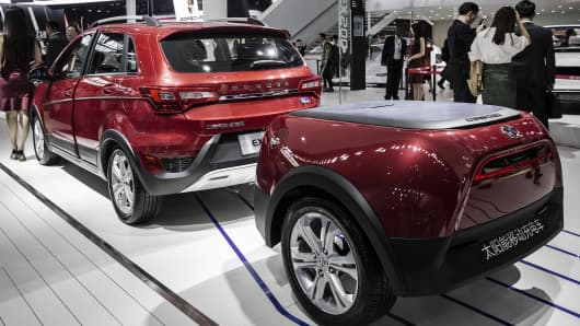 A BAIC Motor EX200 EV electric sports utility vehicle at the Beijing International Automotive Exhibition on April 25, 2016. Tesla Motors and BYD Co. are among manufacturers showing 147 new-energy vehicles at this year's show.