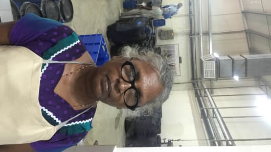 Rasanayagam Sarojinidevi, 64, lost both her sons during the war and is still traumatized, but says she has found a new purpose working at a food processing factory owned by Cargills Ceylon.