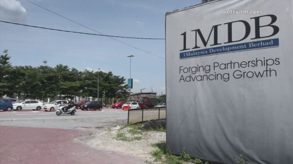 1MDB says some bonds are now in default