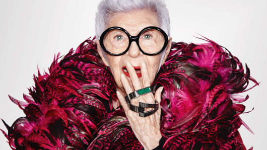 Iris Apfel displays WiseWear's fashionable smart bracelets, which can track activities or send distress alerts using Bluetooth technology.