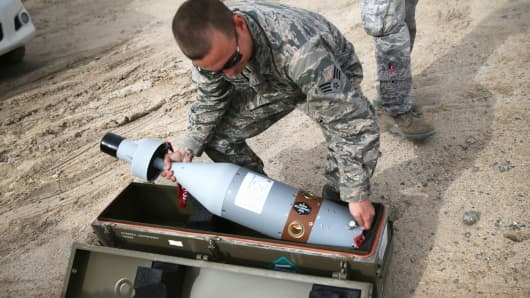 A U.S. Air Force munitions team member uncases the laser-guided tip for a 500 pound bomb to be loaded onto an unmanned aerial vehicle, for airstrikes on ISIL targets on January 8, 2016 at a base in the Persian Gulf Region.