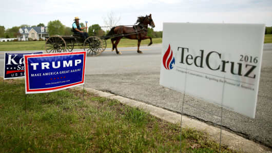 An Amish buggy travels past the White Marsh Elementary School, which today is serving as a polling station, April 26, 2016 in Mechanicsville, Maryland.