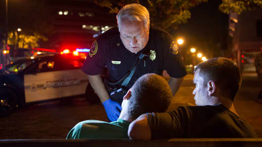 Portland Fire Deputy Chief Terry Walsh responds to a possible heroin overdose by an 18-year-old male in Portland, ME on July 4, 2015.