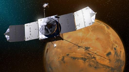 Illustration of MAVEN, NASA's newest Mars orbiter, as it studies the Martian atmosphere.