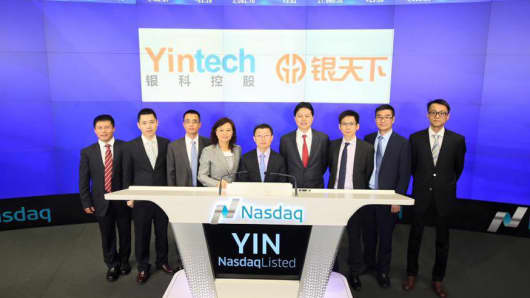 Yintech executives attend the IPO at the Nasdaq, April 27, 2016.