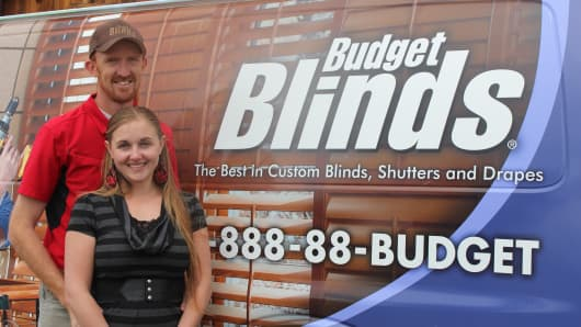 Tev and Annie Kelley of Budget Blinds in Cody, Wyoming. Tev was working as an installer for the franchise in 2007 when he realized he'd rather be an owner.