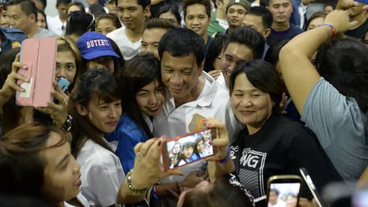 Presidential Candidate Rodrigo Duterte with college students during a campaign sortie in Dagupan, Pangasinan. Duterte curses the pope's mother and jokes about his own infidelities, but many voters in the Philippines want to elect him president so he can begin an unprecedented war on crime.