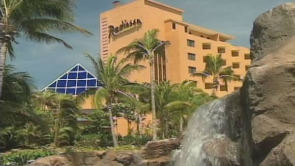 China's HNA to acquire Radisson hotel chain owner