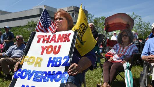 Lee Churchill, of Raleigh, shows her support of HB2 during a rally at the Halifax Mall in Raleigh, N.C., Monday, April 25, 2016.