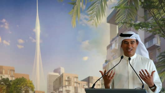 Chairman of Dubai Emaar property Mohamed al-abbar gestures as he speaks to press in Dubai, March 10, 2016. Alabbar said that Emaar, the developer of the world's tallest tower plans to build even a taller tower in this rich Gulf Emirates.
