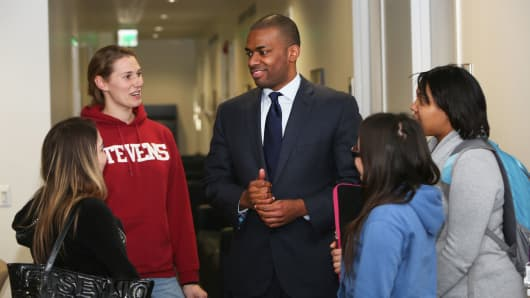 Shavar Jeffries, center, speaks with students
