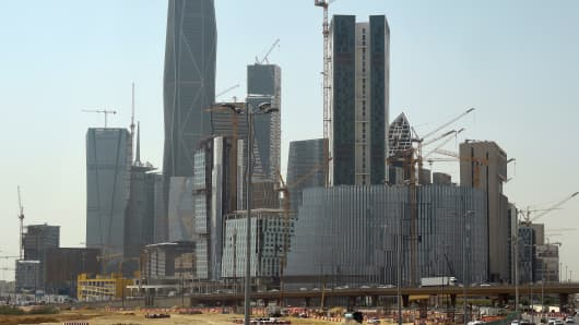 A picture taken on March 9, 2016 shows towers under construction at the King Abdullah Financial District in the Saudi capital Riyadh. Towers in the complex are being built by the Saudi Oger company and other constructors. The unfinished buildings stand as a symbol of the hard times faced by Saudi Oger.