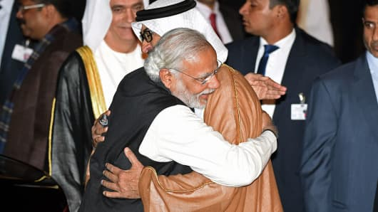 Indian Prime Minister Narendra Modi greets Crown Prince of Abu Dhabi Sheikh Mohammed Bin Zayed Al Nahyan after the prince arrived at an air force base in New Delhi on February 10, 2016. The UAE was the first Middle Eastern country Modi visited as Prime Minister.