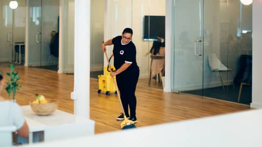 A Managed by Q employee cleans an office in New York City