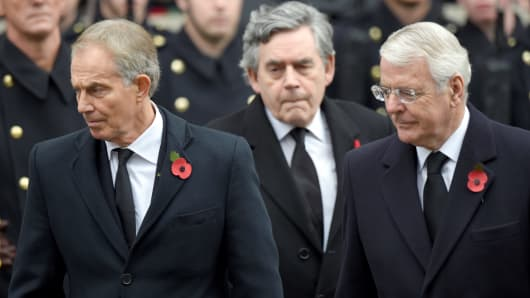 Tony Blair, Gordon Brown and John Major attend the annual Remembrance Sunday Service at the Cenotaph, Whitehall on November 8, 2015 in London, England.