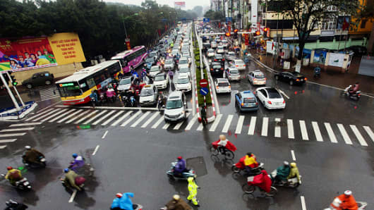 Vehicles sit in traffic at a junction in Hanoi, Vietnam, on Tuesday, Jan. 26, 2016.