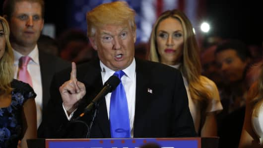 Republican U.S. presidential candidate Donald Trump is surrounded by family members as he speaks during a campaign victory party at Trump Tower in New York on May 3, 2016, after rival candidate Senator Ted Cruz dropped out of the race for the Republican presidential nomination following the results of the Indiana state primary.