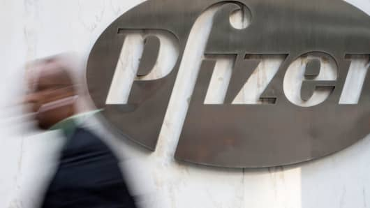 A man walks past Pfizer's world headquarters in New York.