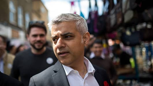 Labour's London Mayoral candidate Sadiq Khan and member of Parliament for Tooting walks through East Street Market in Walworth on May 4, 2016 in London, England.