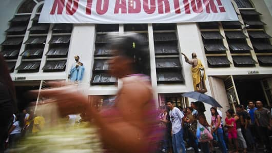 A placard in front of the Minor Basilica of the Black Nazarene in Quiapo during a Catholic Church-backed anti-abortion rally in August 2011 in Manila.
