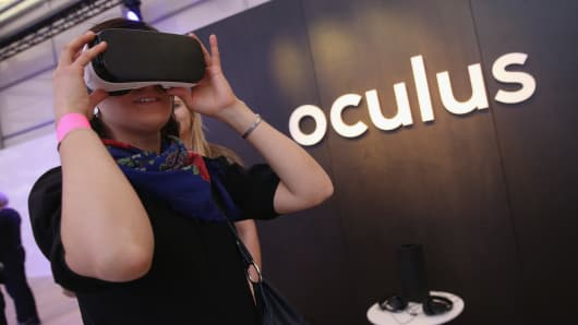 A visitor tries out the Oculus Gear VR virtual reality goggles at the Facebook Innovation Hub on February 24, 2016 in Berlin, Germany.