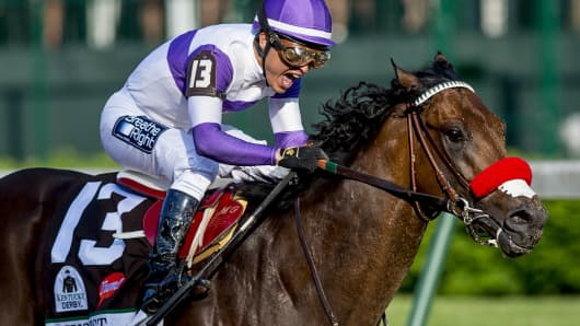 Nyquist #13, ridden by Mario Gutierrez, wins the Kentucky Derby on May 7, 2016 in Louisville, Kentucky.