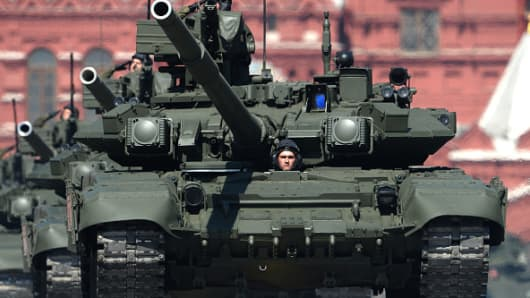 Russian T-90A tanks roll at Red Square during the Victory Day military parade.