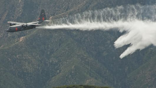Air National Guard C-130 Hercules dropping water last week during a fire-fighting training mission in Southern California.