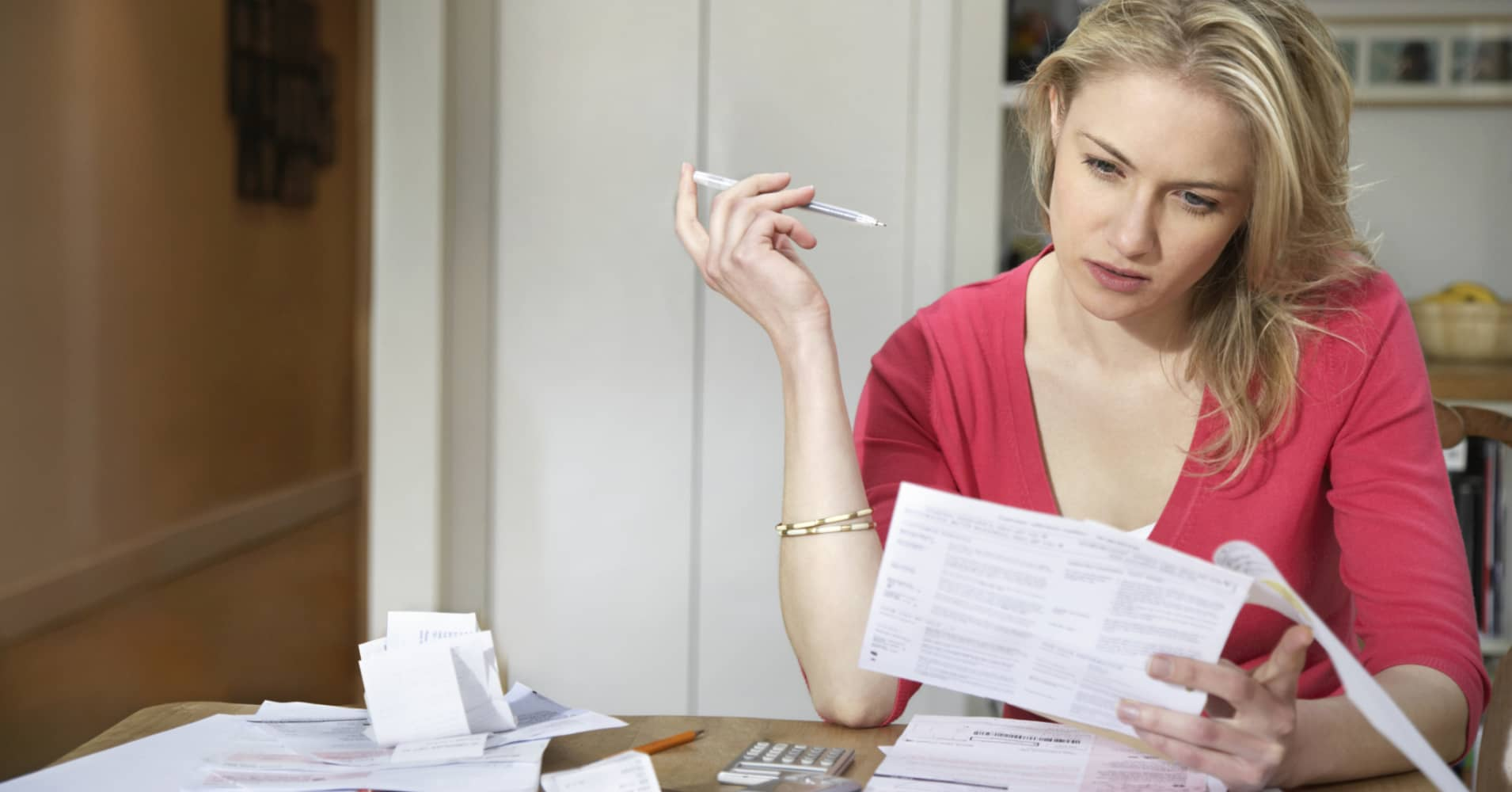 Woman reviewing paper work