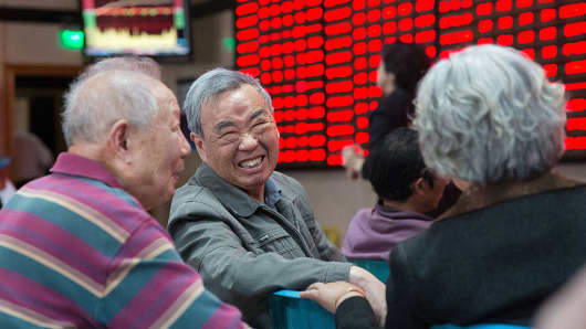 Investors talk at an exchange hall as they observe stock market in Nanjing, Jiangsu Province of China.