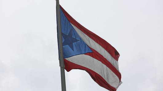 The Puerto Rican flag flies near the Capitol building. US Treasury Secretary Jack Lew warned on Monday that time was running out to address the spiraling crisis in Puerto Rico a week after the island suffered a dramatic default.