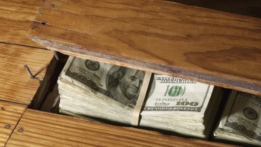 Hiding money under the floor boards