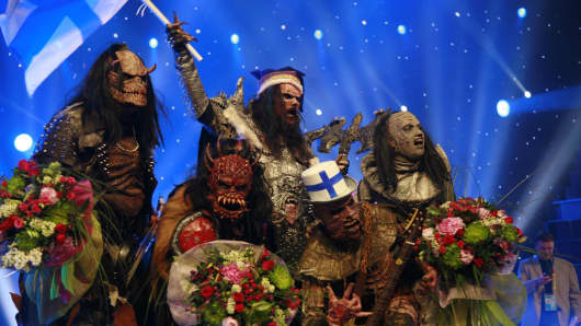 Finland's representative Lordi celebrate after winning the finals of the 2006 Eurovision song contest in Athens' Olympic indoor arena on Saturday, May 20, 2006.